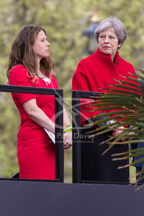 Caroline Criado-Perez, left, and Prime Minister Theresa May.<br /> A statue designed by Turner Prize-winning artist Gillian Wearing OBE of suffragist leader Millicent Fawcett is unveiled in Parliament Square by XXXX. The sculpture is the first-ever monument to a woman and the first designed by a woman to stand within the square and follows the successful campaign by feminist campaigner Caroline Criado-Perez who organised an 85,000 signature petition. London, April 24 2018.