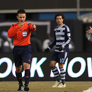 Referee Edvin Jurisevic ponts to the spot awarding a penalty to NYCFC before overturning his ruling after consulting his linesman during the New York City FC Vs Sporting Kansas City, MSL regular season football match at Yankee Stadium, The Bronx, New York,  USA. 27th March 2015. Photo Tim Clayton