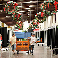 Thomas Wells | Buy at PHOTOS.DJOURNAL.COM<br /> Will Rhodes, left, and Jason Malone haul in a cart load full of gifts for this weeks Celebration Village.