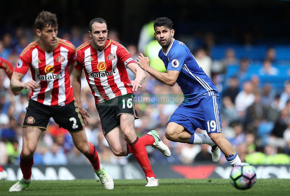 Chelsea's Diego Costa (right) in action with Sunderland's John O'Shea (centre) during the Premier League match at Stamford Bridge, London.