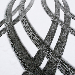 Tire patterns in fresh fallen frozen snow