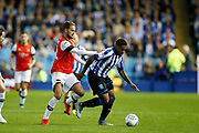 Kadeem Harris of Sheffield Wednesday holds off the challenge of Andrew Shinnie of Luton Town during the EFL Sky Bet Championship match between Sheffield Wednesday and Luton Town at Hillsborough, Sheffield, England on 20 August 2019.