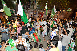 June 18, 2017 - Hyderabad, Sindh, Pakistan - Pakistani youngsters holding Pakistani flag and performing dance after the wining of final match between Pakistan and India in champions trophy on June 18 (Credit Image: © Janali Laghari/Pacific Press via ZUMA Wire)