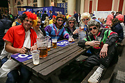Fans drinking beer in fancy dress during the 2019 William Hill World Darts Championship Final at Alexandra Palace, London, United Kingdom on 1 January 2019.