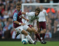 Photo: Lee Earle.<br /> West Ham United v Arsenal. The FA Barclays Premiership. 29/09/2007. West Ham's Mark Noble (L) battles with Mathieu Flamini.