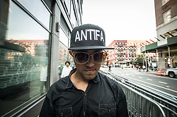 "August 19, 2017 - New York City, New York, United States of America - A demonstrator at the Google offices in NYC wears a hat identifying himself as part of ''Antifa''. In response to the nationwide ""March on Google"" organized by controversial alt-rightist Jack Posobiec, dozens of counter-demonstrators assembled against the encroachment of the far- and radical-right on NYC.  Posobiec has said ''Google is an anti-free speech monopoly'' after Google engineer James Demore was fired for posting a 10-page anti-diversity memo. Ultimately, the event was cancelled citing ""threats from alt-left terrorists"".  Such threats have not been independently confirmed.  Despite the cancellation, protestors continued on, with a slightly altered plan in response to the NYPD's wishes in the wake of the Barcelona terror attack..A US Navy intelligence officer, Posobiec was most noted in his role as special projects director of Citizens for Trump, as well as planting signs near anti-Trump demonstrators and creating disturbances. (Credit Image: © Sachelle Babbar via ZUMA Wire)"