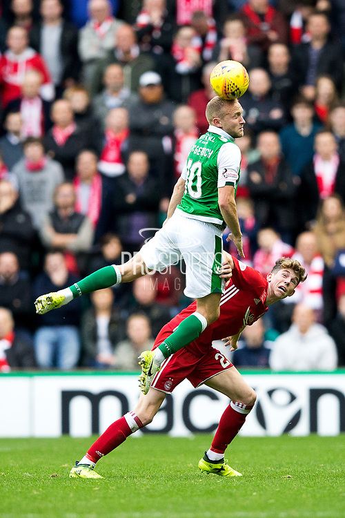 Hibernian midfielder Dylan McGeouch (#10) leaps to win a header in midfield during the Ladbrokes Scottish Premiership match between Hibernian and Aberdeen at Easter Road, Edinburgh, Scotland on 14 October 2017. Photo by Craig Doyle.