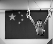 A boy trains at the Shichahai Sports School in Beijing. The Shichahai school is one of China's more famous sports academies and one of its most visited. Criticisms of its harsh practices have been leveled by visiting Western media and sports figures periodically for more than a decade. China has a huge network of sports schools known for recruiting promising young athletes in the hopes of turning them into world champions.