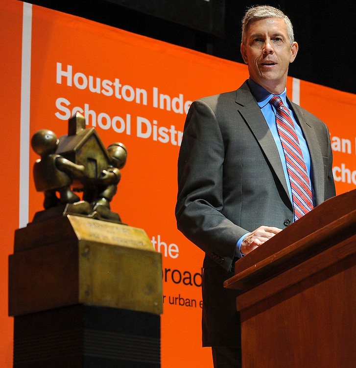 U.S. Secretary of Education Arne Duncan announces that the Houston Independent School District is the winner of the 2013 Broad Prize for Urban Education, Wednesday, Sept. 25, 2013, at the Library of Congress in Washington, D.C.  Houston is the only public school district in the country to win The Broad Prize twice. (Photo by Diane Bondareff/Invision for The Broad Foundation/AP Images)
