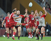Quade Cooper goes to the air for the Reds ~ Super 15 rugby (Round 15) - Reds v Crusaders played at Suncorp Stadium, Brisbane, Australia on Sunday 29th May 2011 ~ Photo : Steven Hight (AURA Images) / Photosport