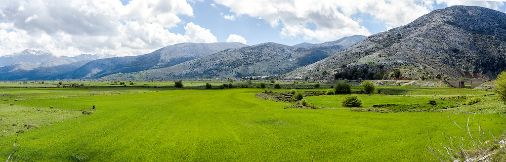 Green pastures of the Plateau of Lassithi in Crete Greece.