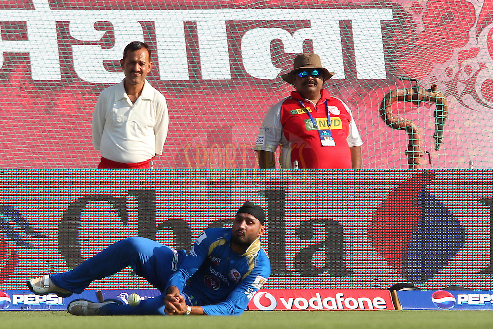 Harbhajan Singh drops the catch during match 69 of the Pepsi Indian Premier League between The Kings XI Punjab and the Mumbai Indians held at the HPCA Stadium in Dharamsala, Himachal Pradesh, India on the on the 18th May 2013..Photo by Ron Gaunt-IPL-SPORTZPICS ..Use of this image is subject to the terms and conditions as outlined by the BCCI. These terms can be found by following this link:..http://www.sportzpics.co.za/image/I0000SoRagM2cIEc