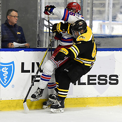 BUFFALO, NY - SEP 21,  2017: Ontario Junior Hockey League Governors Showcase game between the Aurora Tigers and Oakville Blades, Jacob Kostopoulos #47 of the Aurora Tigers makes the hit during the first period.<br /> (Photo by Andy Corneau / OJHL Images)