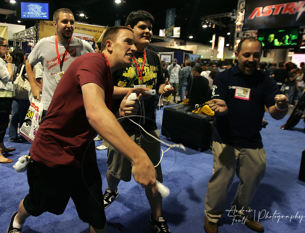 /Andrew Foulk/ For The North County Times/.Craig Douglas, swings a 'wii' controller with force as he tries to beat his friend Jordan Boehl,  during preview night at the 40th annual San Diego Comic Con International.