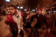 Cairo, Egypt, Dec. 5, 2012-An injured Musliim Brotherhood supporter of President Mohamed Morsi is led towards ambulances during clashes between the Islamist backers of the president and his secular, liberal and non-Islamist opponents near the Presidential Palace. (Photo by Miguel Juarez Lugo)