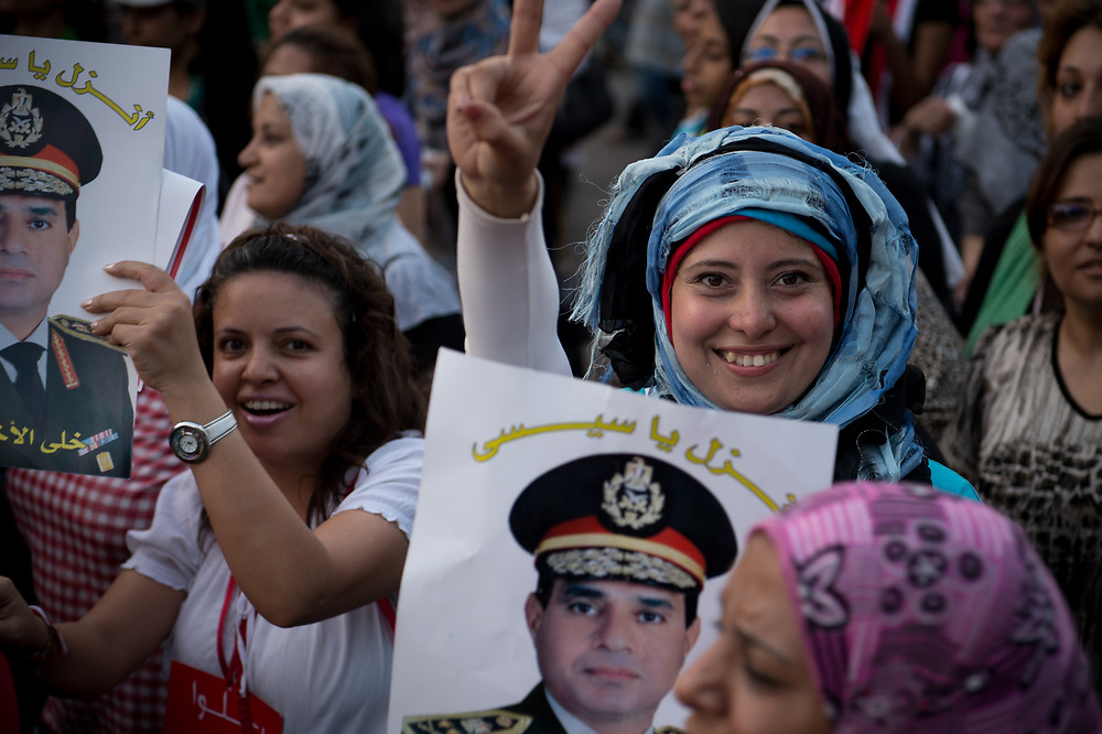 Women hold posters with the face of Abdul Fattah al-Sisi, head of Egypt's armed forces, during a demonstration in Cairo, Egypt, July 7, 2013