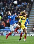 Andy Cannon (14) of Portsmouth battles for possession with Sido Jombati (2) of Wycombe Wanderers during the EFL Sky Bet League 1 match between Portsmouth and Wycombe Wanderers at Fratton Park, Portsmouth, England on 26 December 2019.
