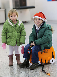 Alex Webster (4) and his sister Sofia (2) from Bromley, Kent, at the departure lounge of Stansted airport as they prepare to jet off with their parents  to Majorca, at the start of the Christmas getaway, Friday, 21st December 2012  Photo by: Stephen Lock / i-Images