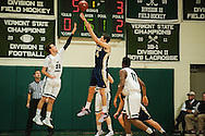 Essex's Eli DiGrande (4) takes a jump shot over Rice's Alex Bond (30) during the boys basketball game between the Essex Hornets and the Rice Green Knights at Rice Memorial high school on Tuesday night December 22, 2015 in South Burlington.(BRIAN JENKINS/for the FREE PRESS)