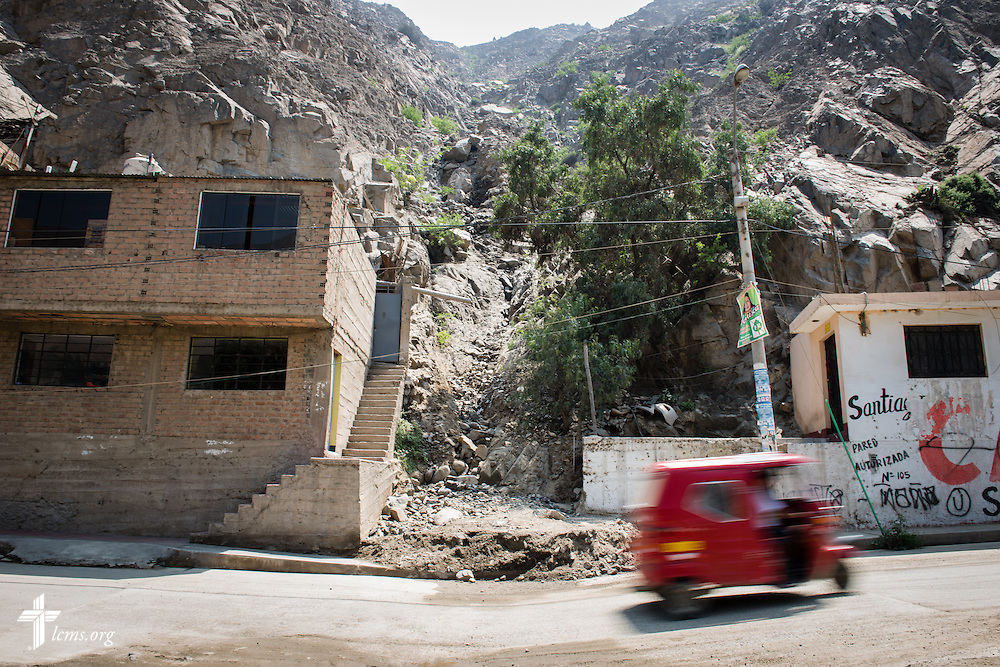 A small vehicle drives past an area affected by a landslide near Huayaringa, Peru, on Tuesday, April 7, 2015. LCMS Communications/Erik M. Lunsford