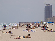 People sunbathing on the beach of Miami Beach USA
