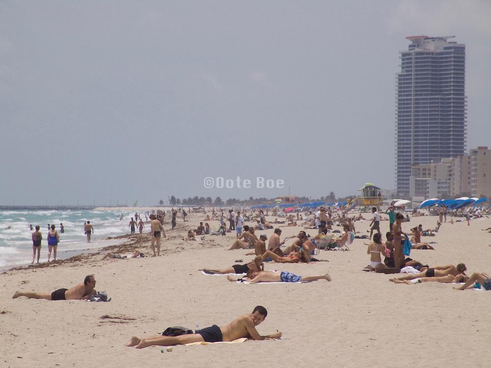 People sunbathing on the beach of Miami Beach USA