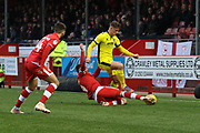 Josh Payne tackles Cameron Pring  during the EFL Sky Bet League 2 match between Crawley Town and Cheltenham Town at the Broadfield Stadium, Crawley, England on 5 January 2019.