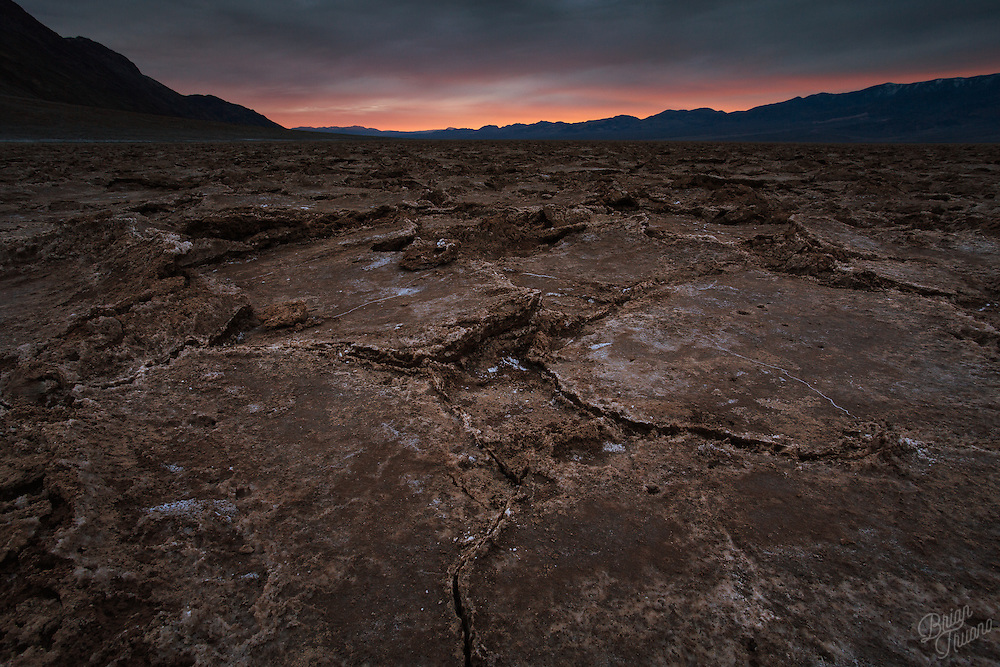 At 279 feet below sea level, Badwater Basin in Death Valley National Park is the lowest point in North America. However, the bedrock lies nearly 8,000 feet below the gravel, sand and mud. Over time it has filled in from glacial runoff and erosion.