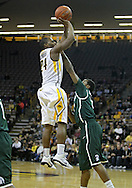 February 2 2011: Iowa Hawkeyes guard Bryce Cartwright (24) puts up a shot over Michigan State Spartans guard Keith Appling (11) during the first half of an NCAA college basketball game at Carver-Hawkeye Arena in Iowa City, Iowa on February 2, 2011. Iowa defeated Michigan State 72-52.
