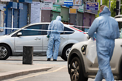 © Licensed to London News Pictures. 27/05/2019. London, UK.  A Police forensic officers at the crime scene in St Paul's Way, Mile End in Tower Hamlets, where a 23 year old man was stabbed multiple times yesterday, 26th May and died overnight in hospital.  Photo credit: Vickie Flores/LNP