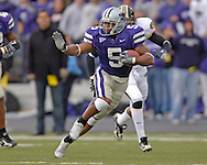 Kansas State running back Thomas Clayton rushes up field against Missouri for a first down in the first quarter at Bill Snyder Family Stadium in Manhattan, Kansas, November 19, 2005.  K-State defeated the Missouri Tigers 36-28.