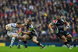London Irish Scrum-Half (#9) Darren Allinson is tackled byHarlequins Flanker (#7) Chris Robshaw (capt) during the first half of the match - Photo mandatory by-line: Rogan Thomson/JMP - Tel: Mobile: 07966 386802 29/12/2012 - SPORT - RUGBY - Twickenham Stadium - London. Harlequins v London Irish - Aviva Premiership - LV= Big Game 5.