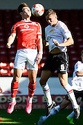 Crewe Alexandra defender Ben Nugent heads the ball away from Walsall striker Tom Bradshaw during the Sky Bet League 1 match between Walsall and Crewe Alexandra at the Banks's Stadium, Walsall, England on 26 September 2015. Photo by Alan Franklin.