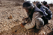 Pioneers in blue flak jackets and helmets probing for landmines near a new training camp for 229 volunteers in Hargeisa, Somaliland. Somaliland is the breakaway republic in northern Somalia that declared independence in 1991 after 50,000 died in civil war. March 1992.