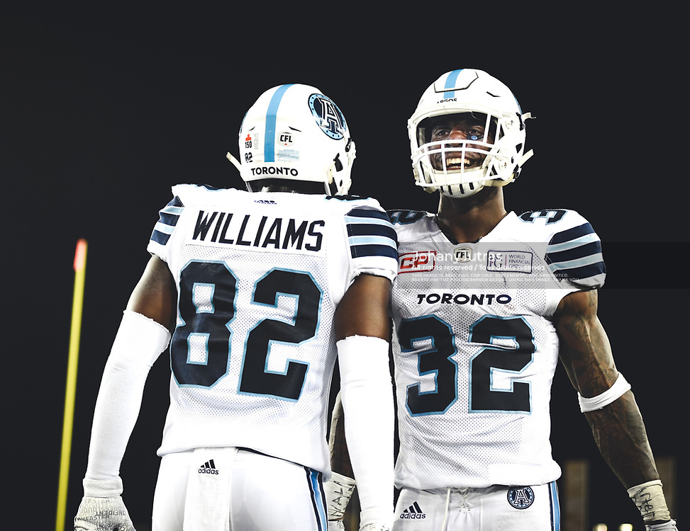 James Wilder Jr. (32) and Malcom Williams (82) of the Toronto Argonauts during the game against the Hamilton Tiger-Cats at Tim Horton's Field in Hamilton, ON, Saturday, September 30, 2017. (Photo: Johany Jutras)