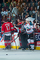 KELOWNA, CANADA - APRIL 8: Linesman Ron Dietterle directs Carsen Twarynski #18 of the Kelowna Rockets to the penalty box against the Portland Winterhawks on April 8, 2017 at Prospera Place in Kelowna, British Columbia, Canada.  (Photo by Marissa Baecker/Shoot the Breeze)  *** Local Caption ***