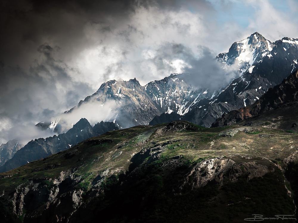Jagged ridges of the Chugach Range cut across the skyline.