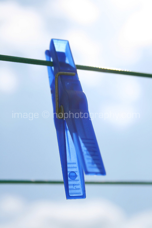 Blue plastic clothes peg on washing line