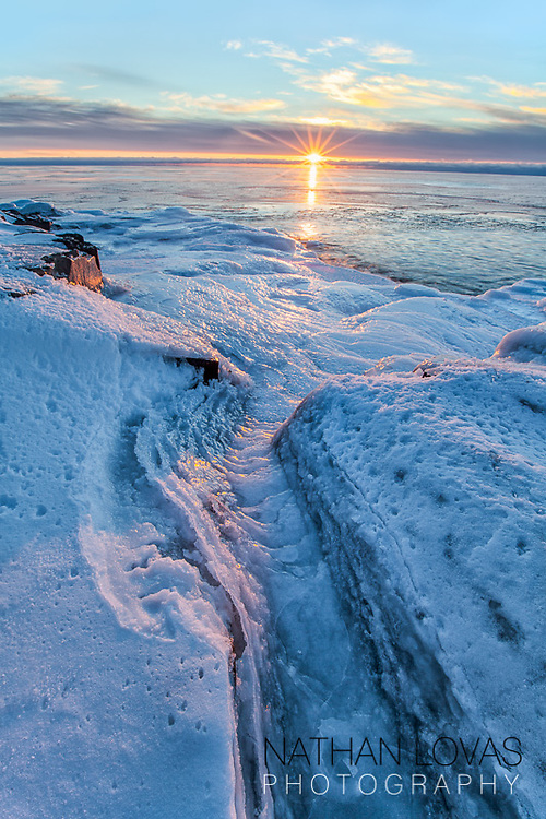 Sunrise on ice covered shoreline on Lake Superior;  MInnesota