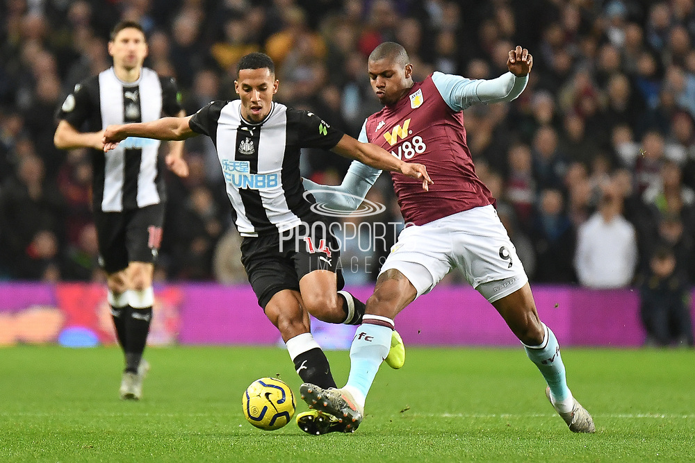 Newcastle United midfielder Isaac Hayden (14) battles for possession  with Aston Villa striker Wesley (9) during the Premier League match between Aston Villa and Newcastle United at Villa Park, Birmingham, England on 25 November 2019.