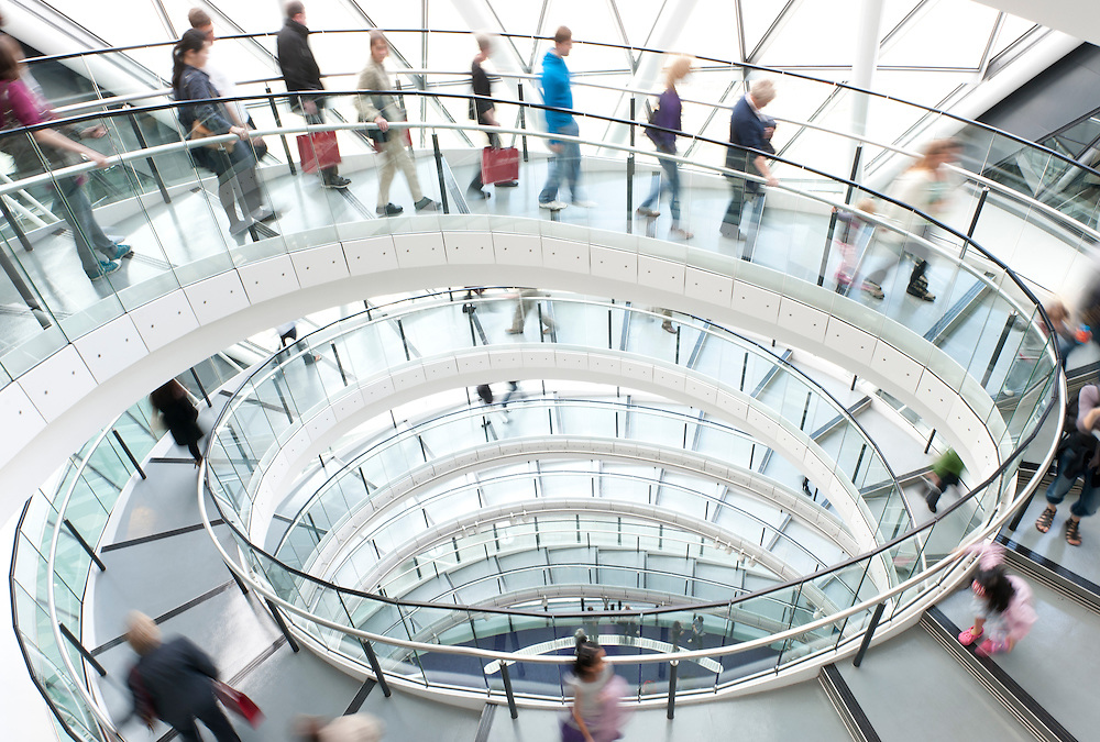 Large group of people walking down a spiral staircase.<br /> Buy here:-<br /> http://www.photoshelter.com/mem/images/#/l/G0000xTgkEOajcno/