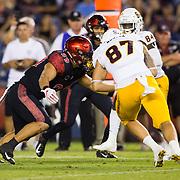 15 September 2018: San Diego State Aztecs linebacker Ronley Lakalaka (39) takes down Arizona State Sun Devils tight end Tommy Hudson (87) in the third quarter. The Aztecs beat the Sun Devils 28-21 at SDCCU Stadium in San Diego, California.