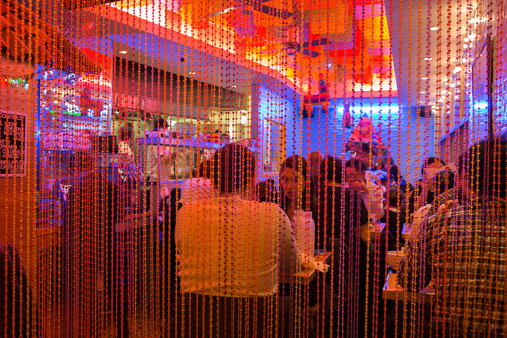 New York, NY - 11 February 2014. A view of the dining room at Mission Cantina seen through the beaded curtain that surrounds the entrance.