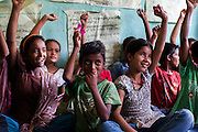 Members of the Kishuri Sachetana Child Club during a meeting in their activity center in Thahuri Tole, Chhinchu, Surkhet district, Western Nepal, on 1st July 2012. These Child Clubs, supported by the government, Save the Children and their local partner NGO Safer Society, advocate for child rights and against child marriages and use peer support and education to end child marriages and raise awareness. Photo by Suzanne Lee for Save The Children UK
