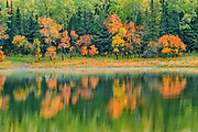 Reflection in Middle Lake at sunrise<br />Kenora<br />Ontario<br />Canada