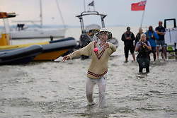 © Licensed to London News Pictures. 18/09/2016. Portsmouth, UK. A fielder drenched in sea water. Teams take part in the  Bramble Bank Cricket Match in the middle of The Solent strait on September 18, 2016. The annual cricket match between the Royal Southern Yacht Club and The Island Sailing Club, takes place on a sandbank which appears for 30 minutes at lowest tide. The game lasts until the tide returns. Photo credit: Ben Cawthra/LNP