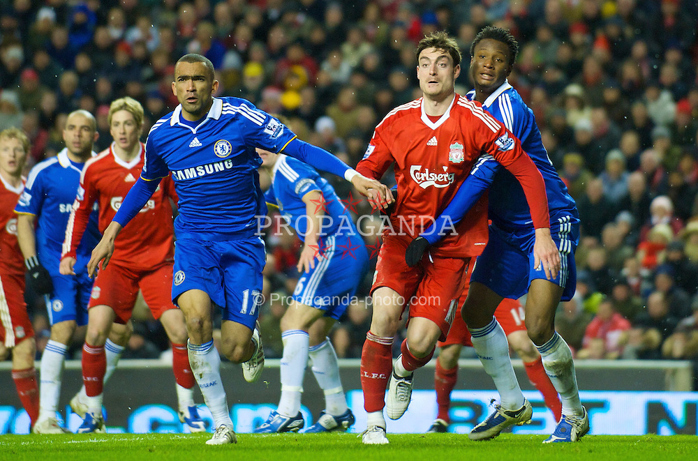 LIVERPOOL, ENGLAND - Sunday, February 1, 2009: Liverpool's Albert Riera and Chelsea's Salomon Kalou during the Premiership match at Anfield. (Mandatory credit: David Rawcliffe/Propaganda)