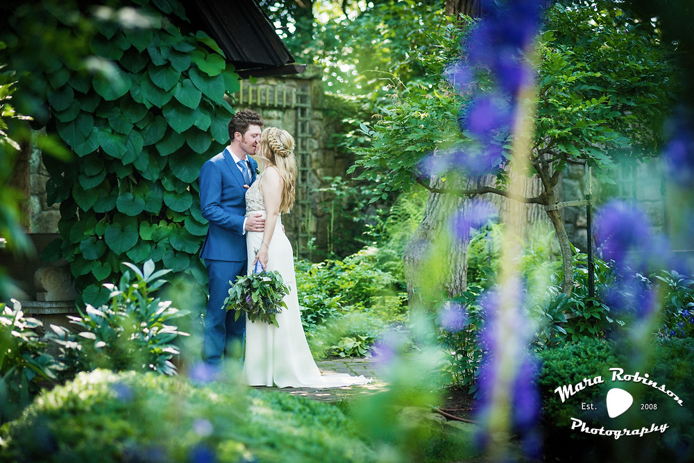 wedding at Stan Hywet, groom kisses bride's  forehead, by Tallmadge wedding photographer, Akron wedding photographer Mara Robinson Photography