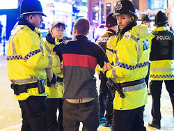 """© Licensed to London News Pictures . 24/12/2016 . Manchester , UK . Police detain a man on Withy Grove . Revellers out in Manchester City Centre overnight during 2016's second """" Mad Friday """" , named for historically being one of the busiest nights of the year for the emergency services in the UK . Photo credit : Joel Goodman/LNP"""