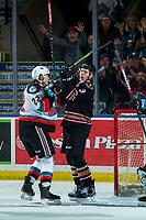KELOWNA, BC - FEBRUARY 17: Dillon Hamaliuk #22 of the Kelowna Rockets pushes back on Evan Toth #3 of the Calgary Hitmen after scoring a goal at Prospera Place on February 17, 2020 in Kelowna, Canada. (Photo by Marissa Baecker/Shoot the Breeze)